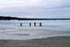 DENE KIDS RIDING BIKES ON THAWING LAKE, COLVILLE LAKE