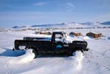 LOC HOL MIS  NT  KJM0103513DOLD TRUCK IN SNOW ABOVE TOWNHOLMAN                               03                   © KEVIN MORRIS                   ALL RIGHTS RESERVEDABANDONED;ARCTIC;AUTOS;BEAUFORT_SEA;HOLMAN;NORTHWEST;NORTHWEST_TERRITORIES;NT_;NWT;SNOW;TERRITORIES;TOWNS;TRANSPORTATION;TRUCKS;VICTORIA_ISLAND;WINTERLONE PINE PHOTO              (306) 683-0889