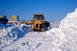 LOC HOL MIS  NT  KJM0103607DBULLDOZER CLEARING SNOWHOLMAN                               03                   © KEVIN MORRIS                   ALL RIGHTS RESERVEDARCTIC;BEAUFORT_SEA;BULLDOZERS;CATERPILLAR;EQUIPMENT;HOLMAN;NORTHWEST;NORTHWEST_TERRITORIES;NT_;NWT;OCCUPATIONS;PEOPLE;ROADS;SNOW;SNOW_REMOVAL;TERRITORIES;VICTORIA_ISLAND;WINTERLONE PINE PHOTO              (306) 683-0889