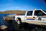 LOC HOL MIS  NT  KJM0112812DR.C.M.P. BOAT BEING LAUNCHEDHOLMAN                               08                  © KEVIN MORRIS                   ALL RIGHTS RESERVEDARCTIC;AUTOS;BOAT_LAUNCHES;BOATS;BEAUFORT_SEA;HILLS;HOLMAN;NORTHWEST;NORTHWEST_TERRITORIES;NT_;NWT;POLICE;RCMP;SHORELINE;SUMMER;TERRITORIES;TOWNS;TRANSPORTATION;TRUCKS;VICTORIA_ISLAND;WATERLONE PINE PHOTO              (306) 683-0889