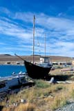 LOC HOL MIS  NT  KJM0113014D  VTBEACHED SAILING BOAT AND CLOUDSHOLMAN                               08                  © KEVIN MORRIS                   ALL RIGHTS RESERVEDARCTIC;BAYS;BEAUFORT_SEA;BOATS;CLOUDS;DRYDOCK;GRAVEL;HOMES;NORTHWEST;NORTHWEST_TERRITORIES;NT_;NWT;ROADS;SAILBOATS;SKY;STRUCTURES;SUMMER;TERRITORIES;TOWNS;TRANSPORTATION;VICTORIA_ISLAND;VTL;WATERLONE PINE PHOTO              (306) 683-0889