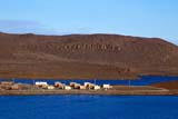 LOC HOL MIS  NT  KJM0113116DBUILDINGS, SEA AND HILLSHOLMAN                               08                  © KEVIN MORRIS                   ALL RIGHTS RESERVEDARCTIC;BEAUFORT_SEA;BUILDINGS;HILLS;HOLMAN;HOMES;NORTHWEST;NORTHWEST_TERRITORIES;NT_;NWT;REMOTE;SCENES;SHORELINE;SKY;STRUCTURES;TERRITORIES;TOWNS;VICTORIA_ISLAND;WATERLONE PINE PHOTO              (306) 683-0889