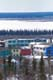 COLOURED ROW HOUSES AND RIVER, INUVIK
