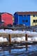 MULTI-COLOURED ROW HOUSES, SNOW STILL ON GROUND, INUVIK