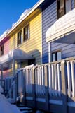 LOC INU MIS  NT  KJM0101104D  VTMULTI-COLOURED ROW HOUSES IN WINTERINUVIK                                 02                  © KEVIN MORRIS                   ALL RIGHTS RESERVEDARCTIC;BUILDINGS;HOMES;INUVIK;MULTI_UNIT_DWELLINGS;NORTHWEST;NORTHWEST_TERRITORIES;NT_;NWT;SNOW;STRUCTURES;TERRITORIES;VTL;WINTERLONE PINE PHOTO              (306) 683-0889
