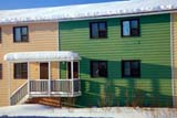 LOC INU MIS  NT  KJM0101504DMULTI-COLOURED ROW HOUSES IN WINTERINUVIK                                 02                  © KEVIN MORRIS                   ALL RIGHTS RESERVEDARCTIC;BUILDINGS;HOMES;INUVIK;MULTI_UNIT_DWELLINGS;NORTHWEST;NORTHWEST_TERRITORIES;NT_;NWT;SHADOWS;SNOW;STRUCTURES;TERRITORIES;WINTERLONE PINE PHOTO              (306) 683-0889