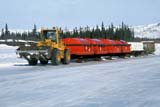 LOC INU MIS  NT  KJM0104908DSKID TRAIN ON ICE ROADMACKENZIE DELTA OIL EXPLORATIONINUVIK                                   04                  © KEVIN MORRIS                   ALL RIGHTS RESERVEDARCTIC;AUTOS;EQUIPMENT;ICE;ICE_ROADS;INDUSTRY;INUVIK;MACKENZIE_RIVER;NORTHWEST;NORTHWEST_TERRITORIES;NT_;NWT;OCCUPATIONS;OIL_AND_GAS;RIVERS;ROADS;SKID_TRAINS;SNOW;SPRING;TERRITORIES;TRANSPORTATION;TREESLONE PINE PHOTO              (306) 683-0889
