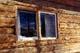 LOG CABIN IN WINDOW IN AUTUMN, T'LOONDIH HEALING SOCIETY, FORT MCPHERSON