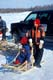 FAMILY WITH CHILD IN SMALL SLED, MUSKRAT JAMBOREE, INUVIK