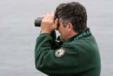 SEA SUM SCE  NL  MTT05A3062DXMAN WITH BINOCULARS VIEWING BIRDSCAPE ST. MARY'S ECOLOGICAL RESERVENEWFOUNDLAND                06..© MIKE TOBIN                     ALL RIGHTS RESERVEDACTIVITIES;ADULTS;ATLANTIC;BINOCULARS;BIRDING;CAPE_ST_MARYS_ECOLOGICAL_RESERVE;EAST_COAST;MALE;MARITIMES;NEWFOUNDLAND;NL_;OUTDOORS;PEOPLE;SUMMERLONE PINE PHOTO              (306) 683-0889