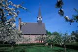 HIS NAT GRA  NS  CRS0000589DMEMORIAL CHURCH AND APPLE ORCHARDGRAND PRE NATIONAL HISTORIC SITE   06© CLIFF SANDESON                             ALL RIGHTS RESERVEDAPPLES;ATLANTIC;BUILDINGS;CHURCHES;DOMESTIC;EAST_COAST;FLOWERS;FRUIT;FRUIT_TREES;GRAND_PRE_NHS;HISTORIC;MARITIMES;MEMORIAL_CHURCH;NOVA;NOVA_SCOTIA;NS_;ORCHARDS;RELIGION;SCENES;SCOTIA;STRUCTURES;SUMMER;TREESLONE PINE PHOTO              (306) 683-0889