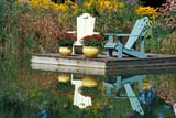 SEA AUT SCE  ON  LDL1000484DADIRONDACK CHAIRS ON DOCKLAKE SCUGOG                       09/..© DIANE LACKIE                    ALL RIGHTS RESERVEDADIRONDACK;AUTUMN;CENTRAL;CHAIRS;COTTAGE;DOCKS;FLOWERS;LAKE_SCUGOG;LAKES;MUSKOKA;ON_;ONTARIO;REFLECTIONS;SCENES;WATERLONE PINE PHOTO              (306) 683-0889