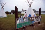 HIS PRO LAC  AB   DSR1000924DSIGN, TEEPEES AND BUILDINGSLAC LA BICHE MISSION HISTORIC SITELAC LA BICHE                      09..© DUANE S. RADFORD         ALL RIGHTS RESERVEDAB_;ABORIGINAL;ALBERTA;CHURCHES;CULTURE;FIRST;FIRST_NATIONS;HISTORIC;LAC_LA_BICHE;LAC_LA_BICHE_MISSION_HISTORIC_SITE;NATIONS;PLAINS;PRAIRIES;RELIGION;SIGNS;SHELTERS;SUMMER;TEEPEESLONE PINE PHOTO              (306) 683-0889
