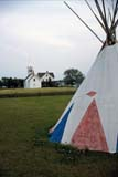HIS PRO LAC  AB  DSR1000926D  VTTEEPEE AND CHURCHLAC LA BICHE MISSION HISTORIC SITELAC LA BICHE                       09/..© DUANE S. RADFORD          ALL RIGHTS RESERVEDAB_;ABORIGINAL;ALBERTA;CHURCHES;CULTURE;FIRST;FIRST_NATIONS;HISTORIC;LAC_LA_BICHE;LAC_LA_BICHE_MISSION_HISTORIC_SITE;PLAINS;NATIONS;PRAIRIES;RELIGION;SHELTERS;STRUCTURES;SUMMER;TEEPEES;VTLLONE PINE PHOTO              (306) 683-0889