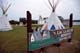 SIGN, TEEPEES AND BUILDINGS, LAC LA BICHE MISSION HISTORIC SITE
