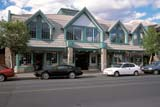 LOC CAN MIS  AB  LJN2103204D  COMMERCIAL BUILDING, MAINSTREETCANMORE                            08/22© LAURA NORRIS                 ALL RIGHTS RESERVEDAB_;ALBERTA;ALPINE;AUTOS;BUILDINGS;CANMORE;CORDILLERA;MAIN_STREETS;PARKING;RETAIL;SHOPPING;STREETS;STRUCTURES;SUMMER;TOWNSLONE PINE PHOTO              (306) 683-0889
