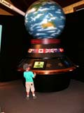 LOC BAN CAN  AB  CWN02D2225D  VT   BOY EXPLORING DISPLAY OF THE WORLDCANADA PLACEBANFF                                     08..© CLARENCE W NORRIS           ALL RIGHTS RESERVEDAB_;ALBERTA;ALPINE;BANFF;BANFF_NP;BOY;CANADA_PLACE;CHILDREN;CORDILLERA;GLOBES;MUSEUMS;NP_;PEOPLE;SUMMER;TOURISM;VTLLONE PINE PHOTO                  (306) 683-0889.