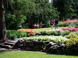LOC BAN CAS  AB  CWN02D2191DPEOPLE WALKING IN FLOWER GARDENSCASCADE GARDENSBANFF                                      08..© CLARENCE W. NORRIS           ALL RIGHTS RESERVEDAB_;ACTIVITIES;ALBERTA;ALPINE;BANFF;BANFF_NP;CASCADE_GARDENS;CORDILLERA;FLOWERS;GARDEN;LANDSCAPING;NP_;OUTDOORS;PARKS;PEOPLE;SUMMERLONE PINE PHOTO                  (306) 683-0889