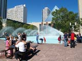 LOC EDM MIS  AB  DSR06C6113DXWADING POOL AND FOUNTAIN IN FRONT OF CITY HALLEDMONTON                        ../..© DUANE S. RADFORD         ALL RIGHTS RESERVEDAB_;ACTIVITIES;ALBERTA;CITY_HALLS;CROWDS;EDMONTON;FOUNTAINS;OUTDOORS;PEOPLE;PICNICS;PLAINS;PLAZAS;POOLS;PRAIRIES;STRUCTURES;SUMMER;URBAN;WATERLONE PINE PHOTO              (306) 683-0889