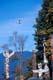 FLOAT PLANE IN SKY OVER TOTEM POLES, STANLEY PARK, VANCOUVER