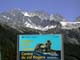 ROGERS PASS CENTER SIGN AND SWISS PEAK, GLACIER NATIONAL PARK