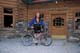 BICYCLIST AT ENTRANCE NUM-TI-JAH LODGE, BOW LAKE, JASPER NATIONAL PARK