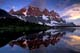THE RAMPARTS REFLECTED IN EARLY MORNING, TONQUIN VALLEY, JASPER NATIONAL PARK