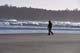 GIRL COLLECTING SHELLS ON BEACH, PACIFIC RIM NATIONAL PARK