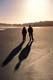 COUPLE WALKING ON SHORE, LONG BEACH, PACIFIC RIM NATIONAL PARK