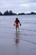 MAN WALKING ON BEACH, LONG BEACH, PACIFIC RIM NATIONAL PARK