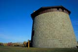 LOC QUE MIS  QC  DSR1001534D  ROUND STONE MARTELLO TOWER PLAINS OF ABRAHAMQUEBEC CITY                      10/..© DUANE S. RADFORD         ALL RIGHTS RESERVEDAUTUMN;CENTRAL;FORTS;HISTORIC;PLAINS_OF_ABRAHAM;QC_;QUEBEC;QUEBEC_CITY;STONE;STRUCTURES;TOWERSLONE PINE PHOTO              (306) 683-0889