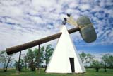 LOC CUT MIS  SK   WS10641DWORLD'S LARGEST TOMAHAWKTOMAHAWK PARKCUTKNIFE                            07/..© WAYNE SHIELS                ALL RIGHTS RESERVEDABORIGINAL;CUTKNIFE;PLAINS;PRAIRIES;SASKATCHEWAN;SCENES;SK_;SKY;SUMMER;TEEPEES;TOMAHAWKS;TOURISMLONE PINE PHOTO              (306) 683-0889