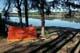 TENT AT LAKESHORE IN SHADY TREES, ANGLIN LAKE