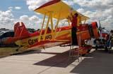 LOC SAS AIR  SK  WDS05B4179DX     MAN WORKING ON AG-CAT BI-PLANECANADA REMEMBERS AIRSHOWSASKATOON                     08..© WAYNE SHIELS               ALL RIGHTS RESERVEDAG_CAT;AIRPLANES;AIRSHOWS;BI_PLANES;CANADA_REMEMBERS_AIRSHOW;MALE;OCCUPATIONS;PEOPLE;PLAINS;PRAIRIES;SASKATCHEWAN;SASKATOON;SK_;TOURISM;TRANSPORTATION LONE PINE PHOTO              (306) 683-0889
