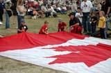 LOC SAS AIR  SK  WDS05B4353DX      PEOPLE WITH CANADIAN FLAGCANADA REMEMBERS AIRSHOWSASKATOON                     08..© WAYNE SHIELS               ALL RIGHTS RESERVEDAIRSHOWS;BOY;CANADA_REMEMBERS_AIRSHOW;CANADIAN;CHILDREN;EVENTS;FLAGS;MALE;PEOPLE;PLAINS;PRAIRIES;SASKATCHEWAN;SASKATOON;SK_;TOURISMLONE PINE PHOTO              (306) 683-0889