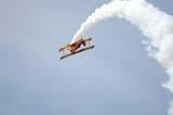 LOC SAS AIR  SK  WDS05B4393DX   AG-CAT BI-PLANE DOING ROLLCANADA REMEMBERS AIRSHOWSASKATOON                     08..© WAYNE SHIELS               ALL RIGHTS RESERVEDAG_CAT_BI_PLANE;AIRPLANES;AIRSHOWS;BI_PLANES;CANADA_REMEMBERS_AIRSHOW;EVENTS;PLAINS;PRAIRIES;SASKATCHEWAN;SASKATOON;SK_;SKY;SMOKE;TOURISM;TRANSPORTATIONLONE PINE PHOTO              (306) 683-0889