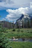 PAR NAT BAN  AB  BRH1703430D  VTCANOE ON VERMILLION LAKES, MT. RUNDLE IN BACKGROUNDBANFF NATIONAL PARK        08/05© BLAKE R. HYDE                ALL RIGHTS RESERVEDAB_;ACTIVITIES;ALBERTA;ALPINE;BANFF_NP;CANOEING;CLOUDS;CORDILLERA;LAKES;MOUNTAINS;MT_RUNDLE;NP_;OUTDOORS;PEOPLE;SCENES;SUMMER;VERMILLION_LAKES;VTL;WATERLONE PINE PHOTO              (306) 683-0889