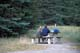 COUPLE AT PICNIC TABLE, UPPER BANKHEAD CAMPSITE, BANFF NATIONAL PARK