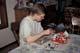 15 YEAR OLD BOY PAINTING FIGURINES, SASKATOON