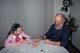 CHILD AND SENIOR PLAYING CARDS, SASKATOON