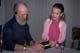 CHILD AND SENIOR LISTENING TO WALKMAN, SASKATOON