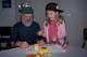CHILD AND SENIOR PLAYING WITH PLAY DOUGH, SASKATOON