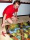 MALE PLAYING BATTLE MASTERS BOARD GAME, SASKATOON