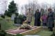 MOURNERS AT GRAVESITE, BARRIE
