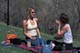 TWO WOMEN SITTING ON BLANKET IN PARK IN SPRING, SASKATOON