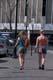 TWO WOMEN WALKING DOWN SIDEWALK, SASKATOON