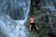 BOY CLIMBING INTO CAVE, MARGARET FALLS, HERALD PROVINCIAL PARK