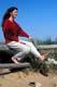 LADY SITTING ON SPLIT RAIL FENCE AT BEACH, CAPE COD