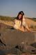 LADY SITTING ON ROCK AT BEACH, CAPE COD NATIONAL SEASHORE PRESERVE