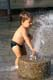 BOY PLAYING WITH WATER SPOUT, SASKATOON